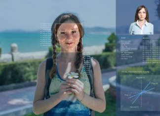Recognition of a female face by layering a mesh and the calculation of the personal data by the software. Biometric verification and identification - ph credits: AdobeStock