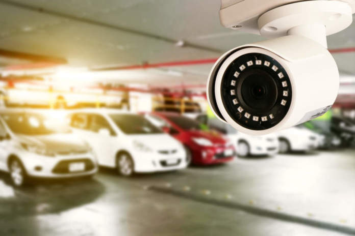 Security CCTV camera in office building installed indoor car park - ph credits: AdobeStock