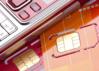 Close-up of mobile phone with sim cards - ph credits: AdobeStock