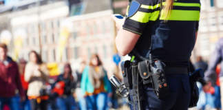 city safety and security. policeman watching order in the urban street - ph credits: AdobeStock